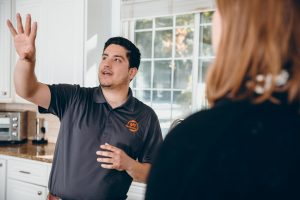 fire damage restoration professional talking with customer